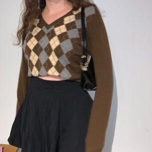 Brown Argyle sweater.